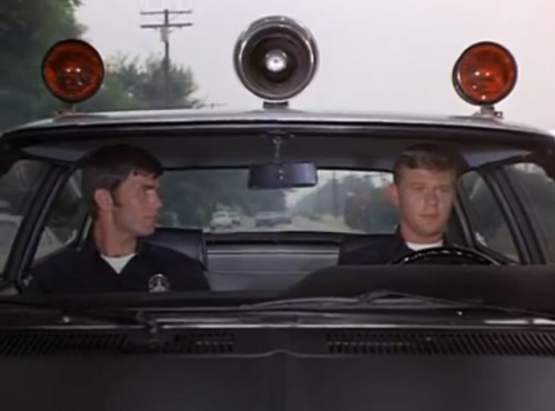 """1-Adam-12, 1-Adam-12. See the post at Bionic Disco. A disturbance."" (Kent McCord & Martin Milner, 1973)"