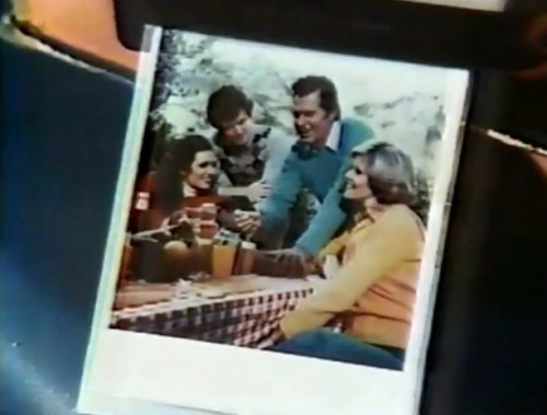A screengrab of a picture of people looking at a picture. Mind blown? (Polaroid One Step commercial, 1978)