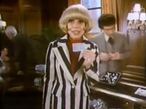 Carol Channing whips out her Amex to purchase some diamonds, 1977
