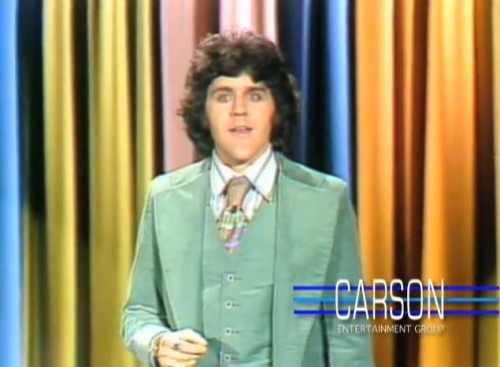 A young Leno dreams of one day changing these curtains. ('The Tonight Show,' 1977)