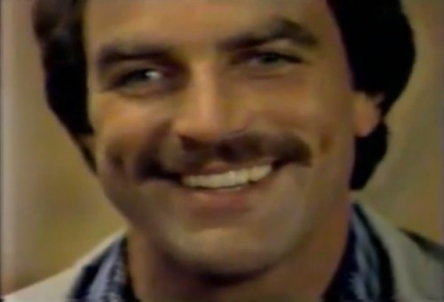 A pre-'Magnum, P.I.,' Tom Selleck flashes his pearly whites for Close-Up. (1977)