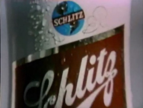 Young Adults: 'Hey, Schlitz. I'm hot & thirsty.' Schlitz Mascot: 'Oh, yeah!!'