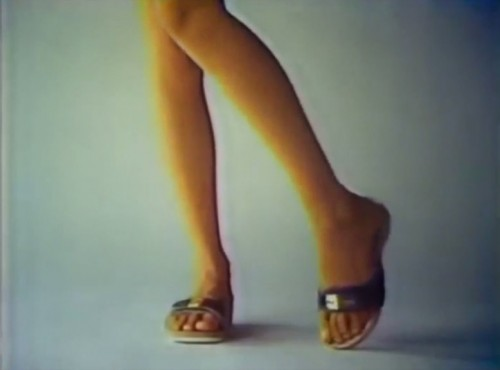She's got...sandals...and she knows how to use 'em (Scholl commercial, 1977)