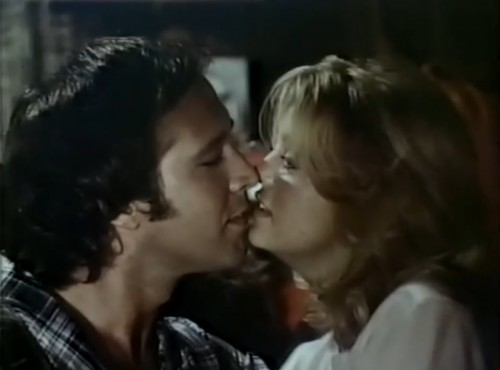 Chevy Chase and Goldie Hawn share a kiss in 'Foul Play,' 1978