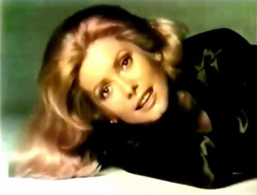 Catherine Deneuve lying down on the job. (Chanel commercial, 1971)