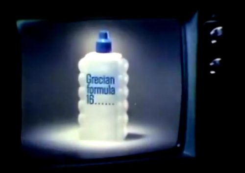 A bottle on the box. (Grecian Formula 16 commercial, 1975)